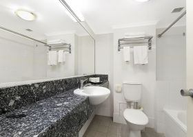 Queen Studio Apartment Bathroom - The Wellington Apartments Hotel Brisbane